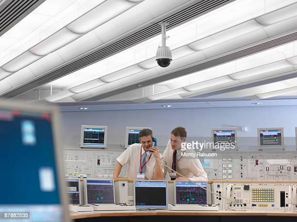 Operators on telephone in control room