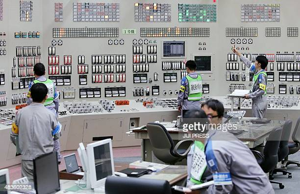 Operators restart the nuclear reactor at the central control room of the Kyushu Electric Power Sendai nuclear power plant in Satsumasendai Kagoshima...