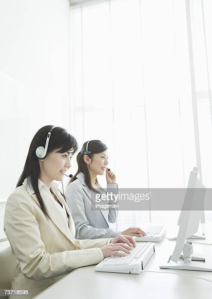 Operators wearing headphones in the office