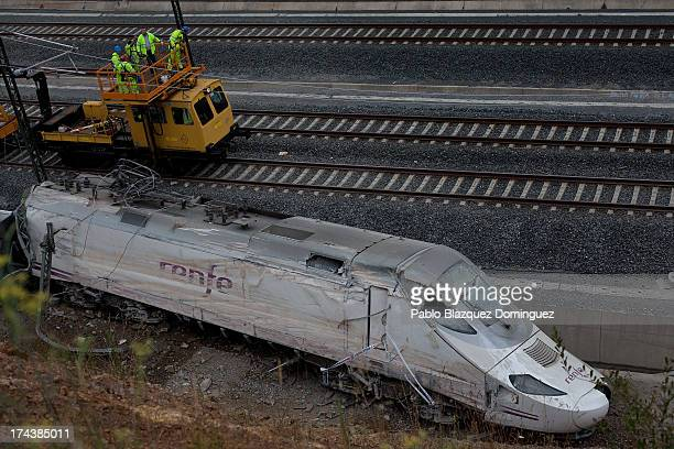 Operators work at the scene of a train crash that killed at least 77 people on July 25 2013 at Angrois near Santiago de Compostela Spain The crash...