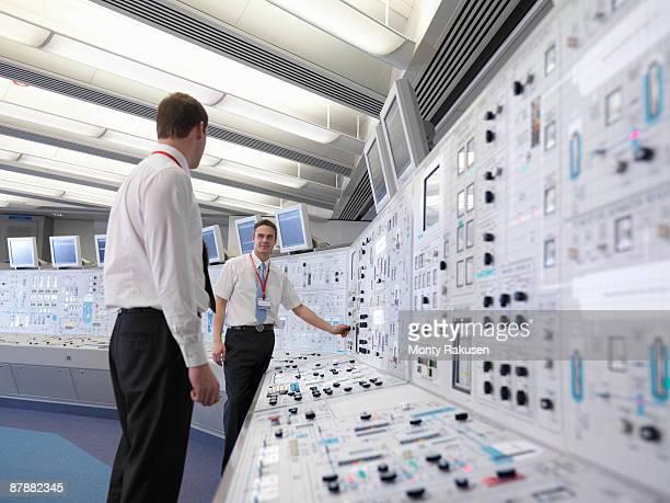 Operators working in control room