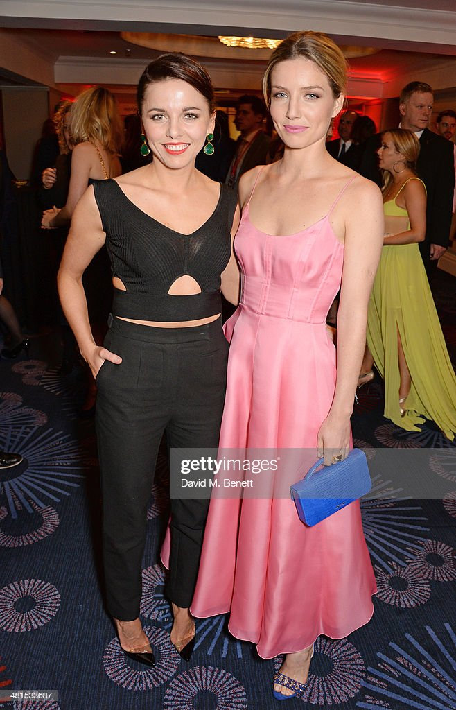 Ophelia Lovibond (L) and Annabelle Wallis arrive at the Jameson Empire Awards 2014 at The Grosvenor House Hotel on March 30, 2014 in London, England.