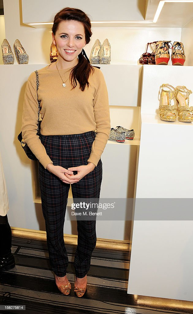 Ophelia Lovibond attends a Christmas drinks hosted by designer Nicholas Kirkwood to celebrate his partnership with Chambord black raspberry liquer, and launch the limited edition shoe 'The Chambord' at the Nicholas Kirkwood Mount Street store on December 12, 2012 in London, England.