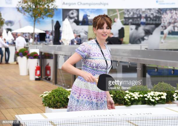 Ophelia Lovibond celebrates with Moet Ice Imperial in the Moet Chandon Suite whilst watching the action unfold on Centre Court at the Aegon...