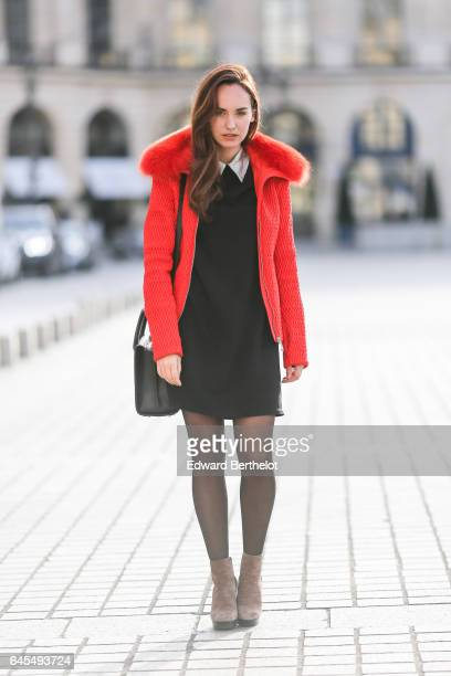 Ophelie Duvillard model and fashion blogger wears a Rue des Abesses black dress with a white collar a Fusalp red winter coat with fur Hogan brown...