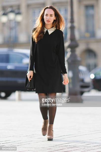 Ophelie Duvillard model and fashion blogger wears a Rue des Abesses black dress with a white collar Hogan brown suede boots black tights and a Furla...