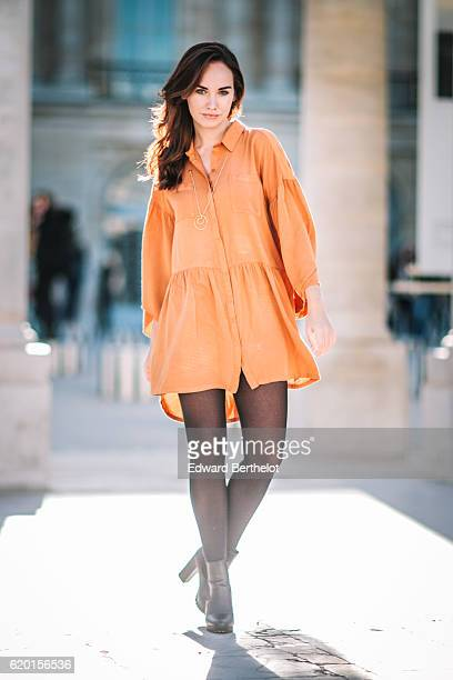 Ophelie Duvillard wears an orange Miss K dress Primark black heels shoes a golden necklace and L'Oreal Gold Obession lipstick on November 1 2016 in...