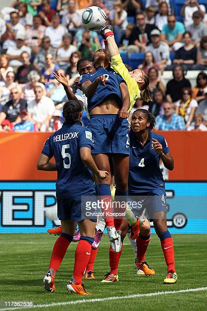 Ophelie Meilleroux and Wendie Renard of France Rita Chikwelu of Nigeria and Berangere Sapowicz of France and Laura Georges of France go up for a...