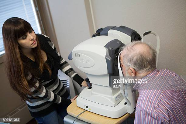 Ophtalmological practice Geneva Switzerland The medical secretary carries out an optical biometry with an auto keratorefracto tonometer