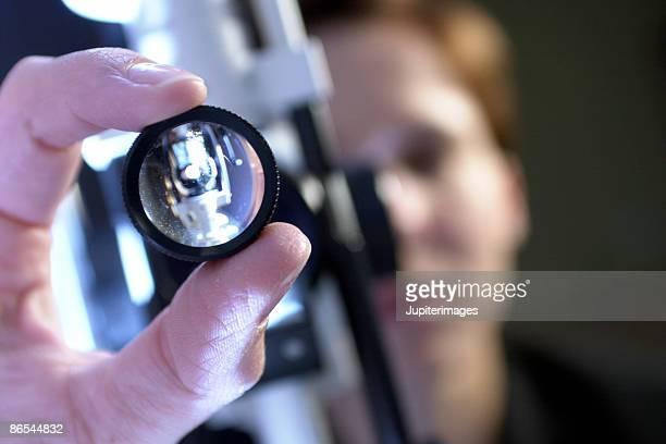 Ophthalmologist adjusting slit lamp
