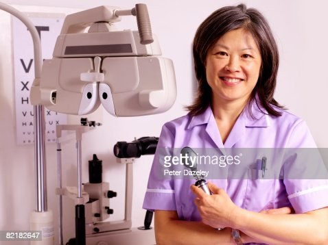 Ophthalmologist with phoropter : Stock Photo