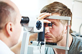 Ophthalmology concept. Male patient under eye vision examination in eyesight ophthalmological correction clinic