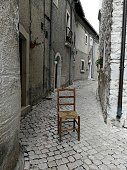 Opi, L'Aquila, Abruzzo, Italy - September 15, 2018: Chair in wood and straw in the alleys of the historic center