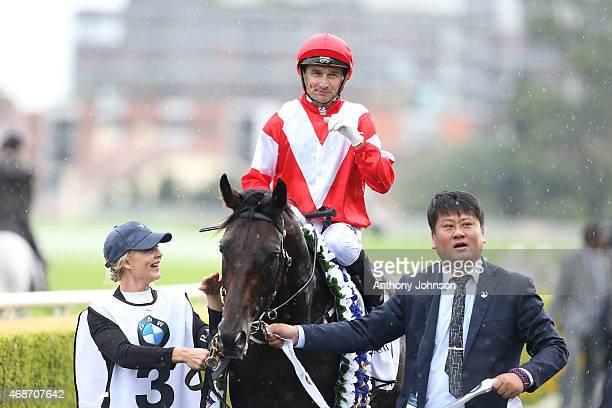 Opie Bosson returns on Mongolian Khan after winning race 7 The BMW Australian Derby during Sydney Racing at Royal Randwick Racecourse on April 6 2015...