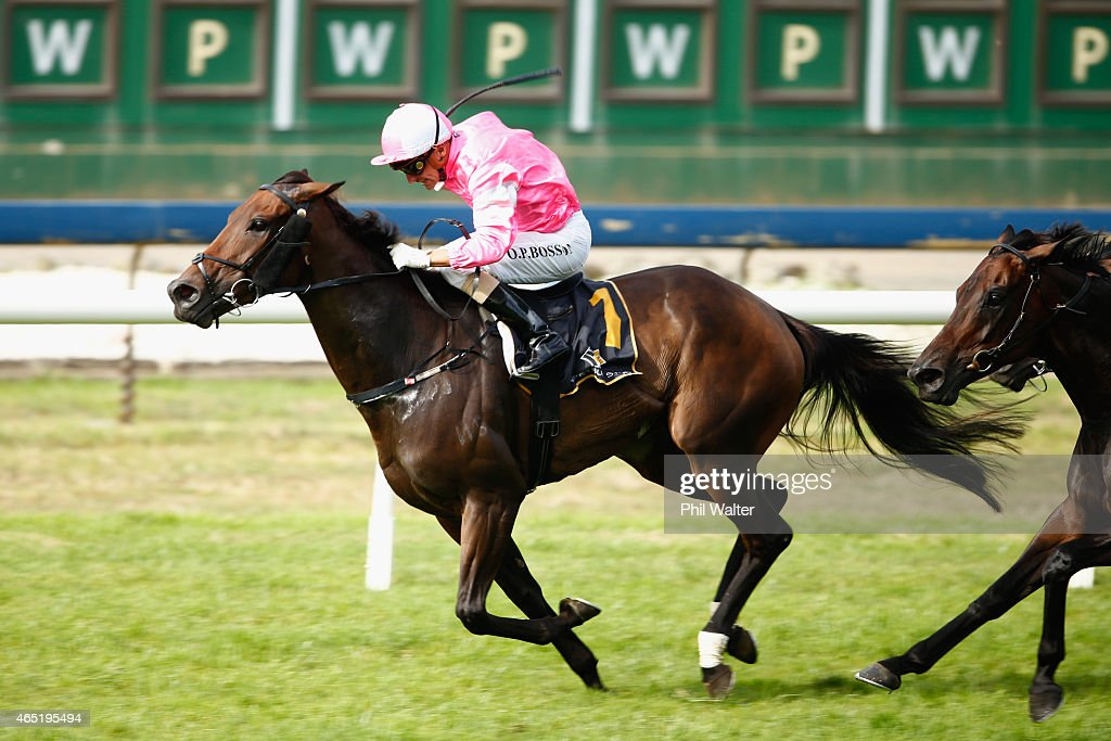 Opie Bosson riding Diademe wins the Westbury Classic during Auckland Cup Day at Ellerslie Racecourse on March 4 2015 in Auckland New Zealand