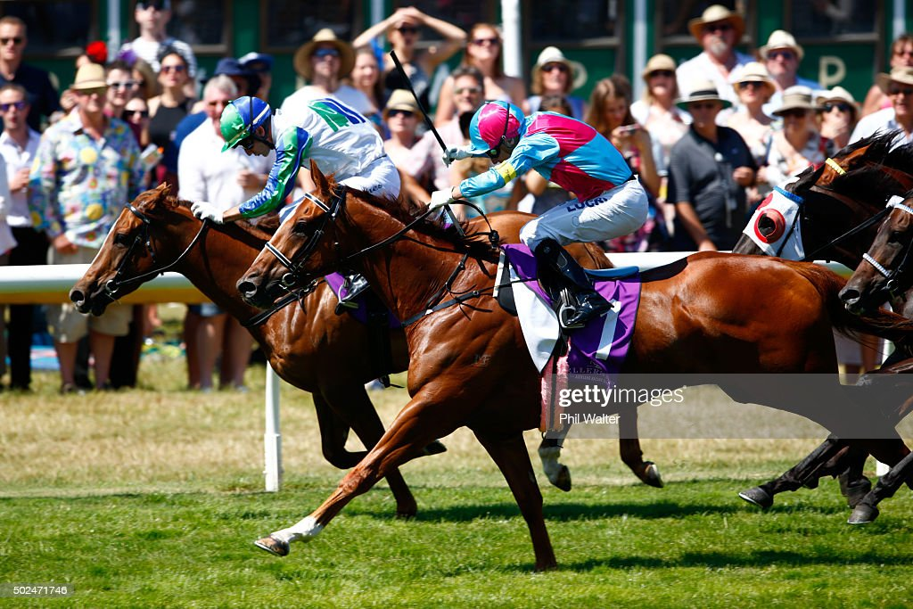 Opie Bosson riding Fully Funded wins the Auckland CoOp Taxis 1200 during the Boxing Day races at Ellerslie on December 26 2015 in Auckland New Zealand