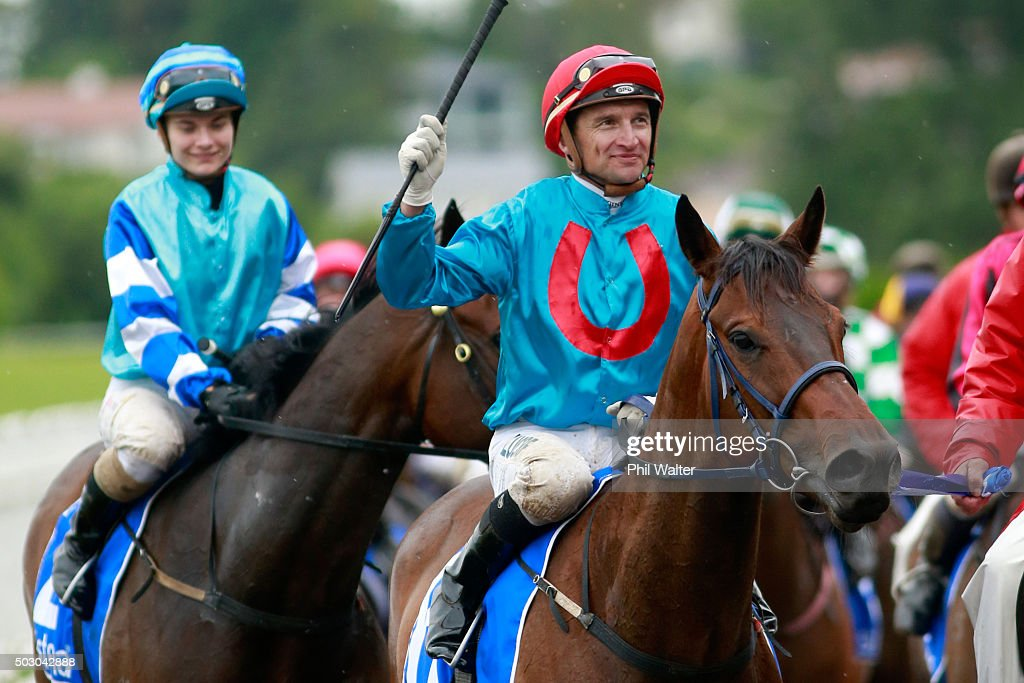 Opie Bosson riding Ryan Mark celebrates after winning the Railway Stakes at Ellerslie Racecourse on January 1 2016 in Auckland New Zealand