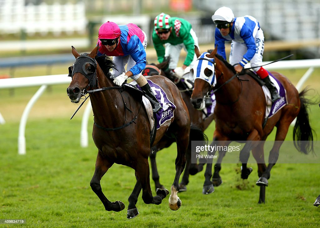 Opie Bosson riding Show The World wins The Sound Championship Stakes during the New Years Day racing at Ellerslie Racecourse on January 1 2014 in...