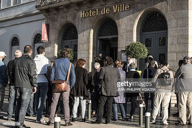 Opponants to the City Council meeting regarding a pork alternative menu gather outside the Mayor's offices on September 29 2015 in ChalonsurSaone...
