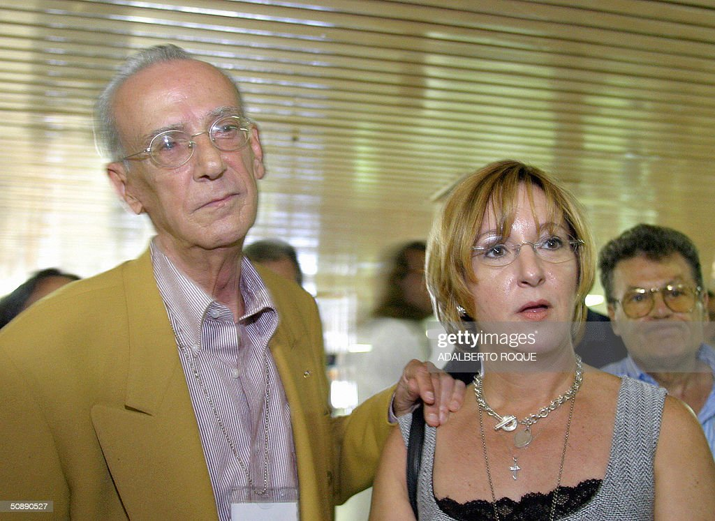 Opponent to Cuban President Fidel Castro, Cambio Cubano (Cuban Change) leader Eloy Gutierrez Menoyo, and his daughter Patricia Gutierrez, answer questions to journalists upon the closure of the Nation and Migration conference in Havana, 23 May 2004. Gutierrez Menoyo, a former political prisoner who moved back to Cuba from Miami in 2003 though without official authorization, attended the conference to discuss with Government authorities about mutual concerns on migration. AFP PHOTO/Adalberto ROQUE