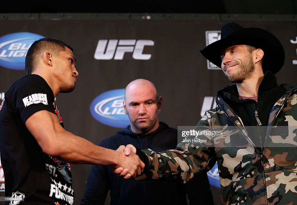 Opponents <a gi-track='captionPersonalityLinkClicked' href=/galleries/search?phrase=Anthony+Pettis&family=editorial&specificpeople=7204428 ng-click='$event.stopPropagation()'>Anthony Pettis</a> and Donald 'Cowboy' Cerrone shake hands during the UFC on FOX press conference on January 24, 2013 at the United Center in Chicago, Illinois.