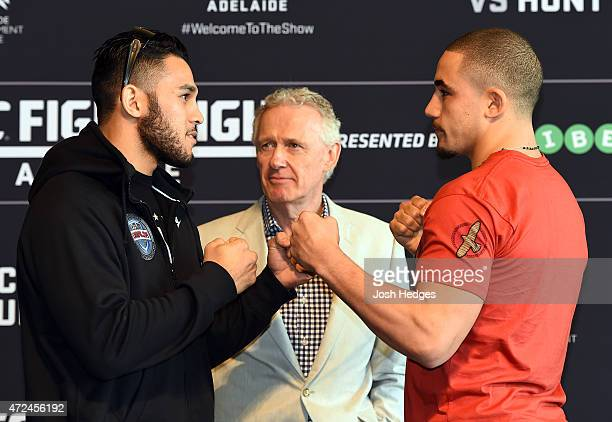 Opponents Brad Tavares of the United States and Robert Whittaker of Australia face off during the UFC Ultimate Media Day at the Adelaide Oval on May...