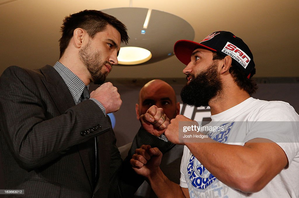 Opponents <a gi-track='captionPersonalityLinkClicked' href=/galleries/search?phrase=Carlos+Condit&family=editorial&specificpeople=7049007 ng-click='$event.stopPropagation()'>Carlos Condit</a> and Johny Hendricks face off during the final press conference ahead of his UFC 158 bout at Bell Centre on March 14, 2013 in Montreal, Quebec, Canada.