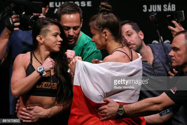 Opponents Claudia Gadelha of Brazil and Karolina Kowalkiewicz of Poland face off during the UFC Fight Night weighin at Jeunesse Arena on June 02 2017...