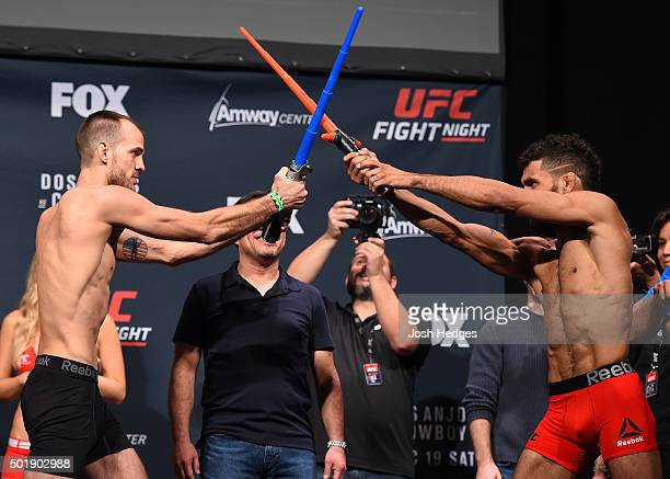 Opponents Cole Miller and Jim Alers face off during the UFC weighin at the Orange County Convention Center on December 18 2015 in Orlando Florida