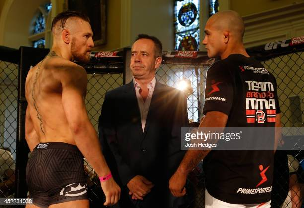 Opponents Conor McGregor and Diego Brandao face off during the UFC media day at Royal Hospital Kilmainham on July 16 2014 in Dublin Ireland