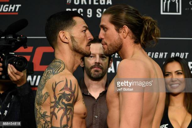 Opponents Cub Swanson and Brian Ortega face off during the UFC Fight Night weighin inside Valdez Hall on December 8 2017 in Fresno California