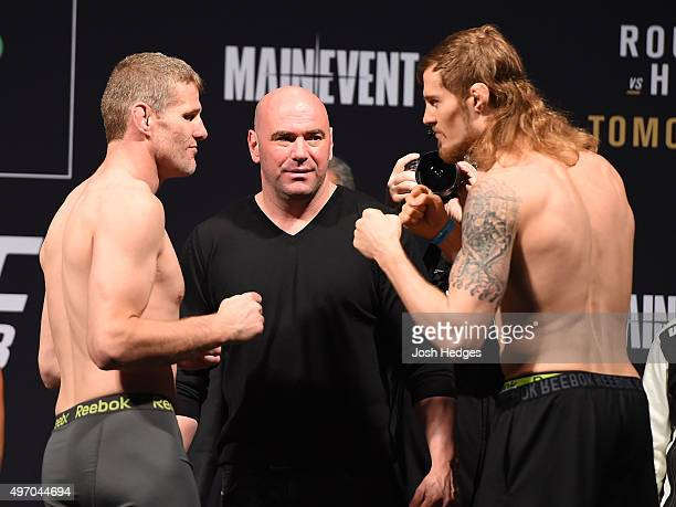 Opponents Daniel Kelly of Australia and Steve Montgomery of the United States face off during the UFC 193 weighin at Etihad Stadium on November 14...