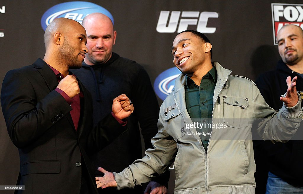 Opponents Demetrious 'Mighty Mouse' Johnson and John Dodson face off during the UFC on FOX press conference on January 24, 2013 at the United Center in Chicago, Illinois.