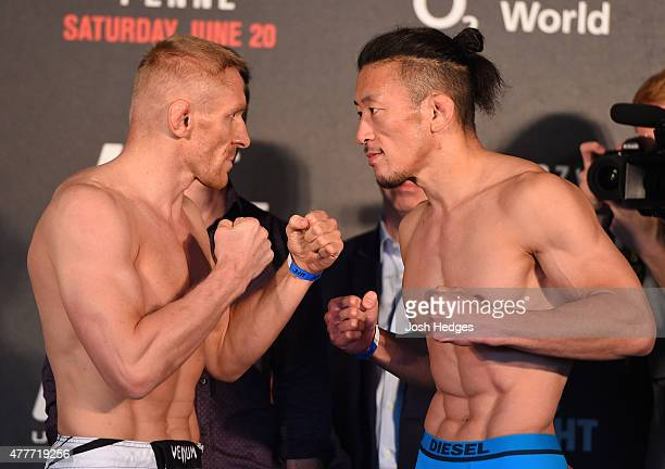 Opponents Dennis Siver of Germany and Tatsuya Kawajiri of Japan face off during the UFC Berlin weighin at the O2 World on June 19 2015 in Berlin...