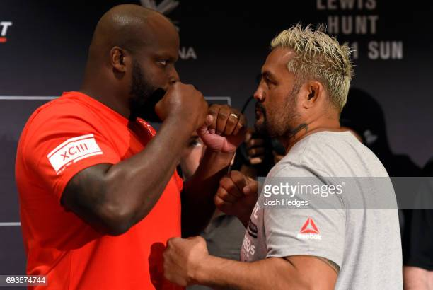 Opponents Derrick Lewis and Mark Hunt of New Zealand face off during the UFC Fight Night Ultimate Media Day at the Langham Hotel on June 8 2017 in...
