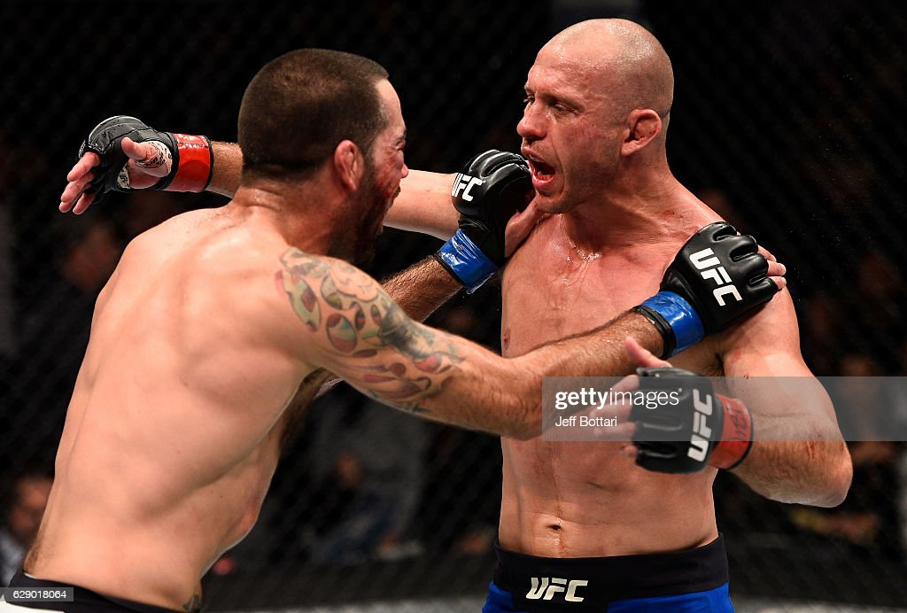 Opponents Donald Cerrone and Matt Brown hug at the start of the third and final round in their welterweight bout during the UFC 206 event inside the Air Canada Centre on December 10, 2016 in Toronto, Ontario, Canada.