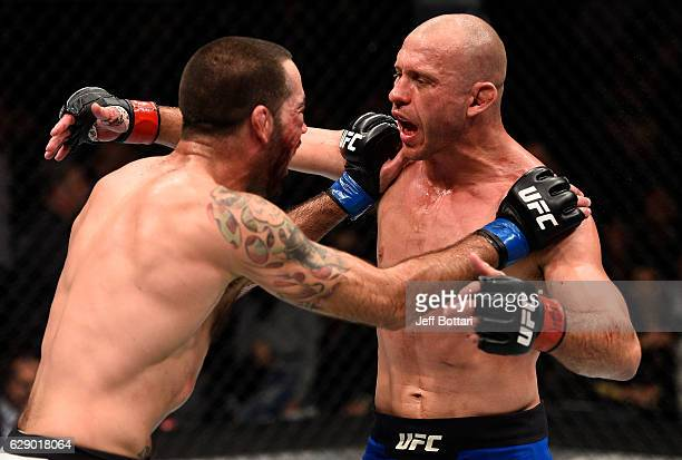 Opponents Donald Cerrone and Matt Brown hug at the start of the third and final round in their welterweight bout during the UFC 206 event inside the...