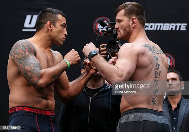 Opponents Fabricio Werdum of Brazil and Stipe Miocic of the United States face off during the UFC 198 weighin at Arena da Baixada stadium on May 13...