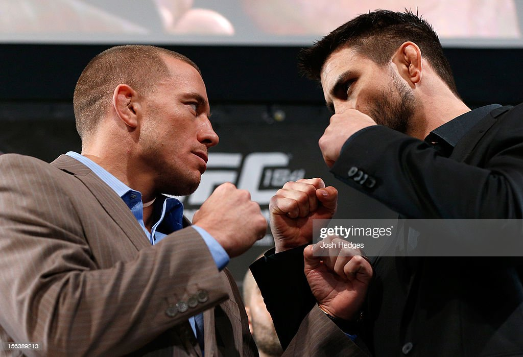Opponents Georges St-Pierre and Carlos Condit face off during the final pre-fight press conference ahead of UFC 154 at New City Gas on November 14, 2012 in Montreal, Quebec, Canada.