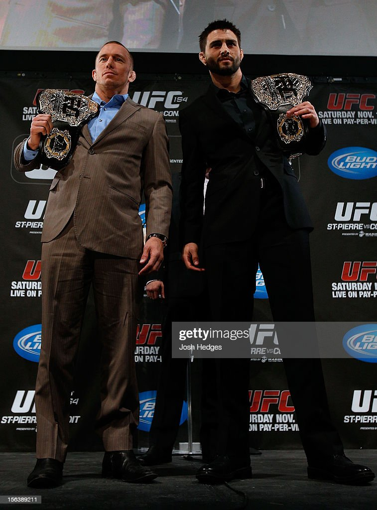 Opponents <a gi-track='captionPersonalityLinkClicked' href=/galleries/search?phrase=Georges+St-Pierre&family=editorial&specificpeople=4864241 ng-click='$event.stopPropagation()'>Georges St-Pierre</a> and <a gi-track='captionPersonalityLinkClicked' href=/galleries/search?phrase=Carlos+Condit&family=editorial&specificpeople=7049007 ng-click='$event.stopPropagation()'>Carlos Condit</a> pose for photos during the final pre-fight press conference ahead of UFC 154 at New City Gas on November 14, 2012 in Montreal, Quebec, Canada.