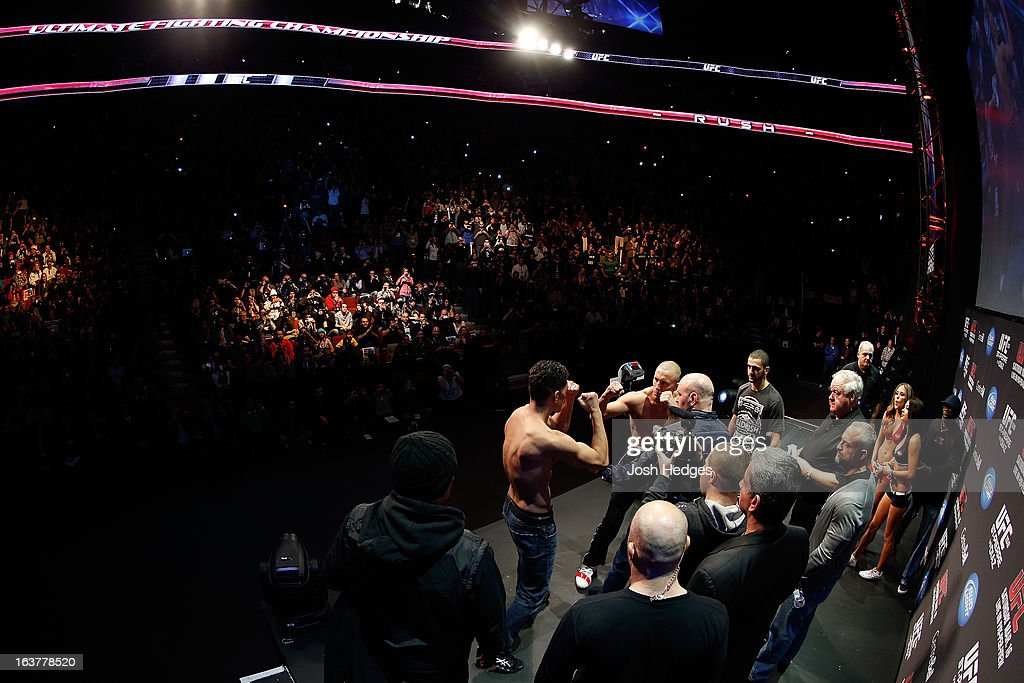 Opponents <a gi-track='captionPersonalityLinkClicked' href=/galleries/search?phrase=Georges+St-Pierre&family=editorial&specificpeople=4864241 ng-click='$event.stopPropagation()'>Georges St-Pierre</a> and <a gi-track='captionPersonalityLinkClicked' href=/galleries/search?phrase=Nick+Diaz&family=editorial&specificpeople=5350175 ng-click='$event.stopPropagation()'>Nick Diaz</a> face off during the UFC 158 weigh-in at Bell Centre on March 15, 2013 in Montreal, Quebec, Canada.
