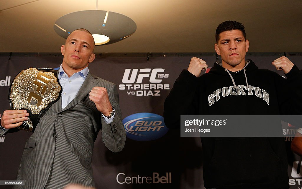 Opponents <a gi-track='captionPersonalityLinkClicked' href=/galleries/search?phrase=Georges+St-Pierre&family=editorial&specificpeople=4864241 ng-click='$event.stopPropagation()'>Georges St-Pierre</a> and <a gi-track='captionPersonalityLinkClicked' href=/galleries/search?phrase=Nick+Diaz&family=editorial&specificpeople=5350175 ng-click='$event.stopPropagation()'>Nick Diaz</a> pose for photos during the final press conference ahead of his UFC 158 bout at Bell Centre on March 14, 2013 in Montreal, Quebec, Canada.