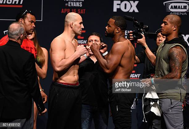 Opponents Glover Teixeira of Brazil and Rashad Evans face off during the UFC Fight Night weighin at Ruth Eckerd Hall on April 15 2016 in Clearwater...