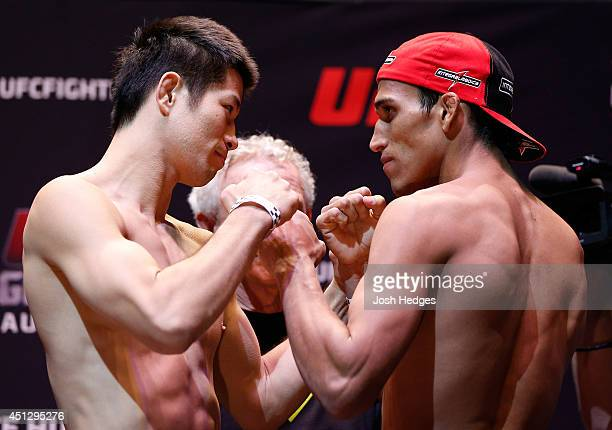 Opponents Hatsu Hioki of Japan and Charles Oliveira of Brazil during the UFC weighin at Vector Arena on June 27 2014 in Auckland New Zealand