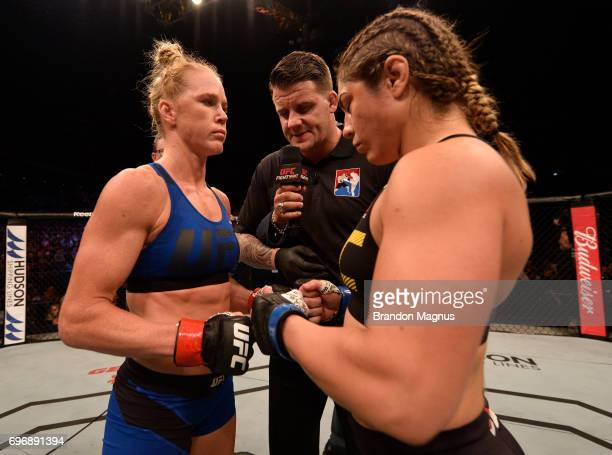Opponents Holly Holm and Bethe Correia of Brazil face off prior to their women's bantamweight bout during the UFC Fight Night event at the Singapore...