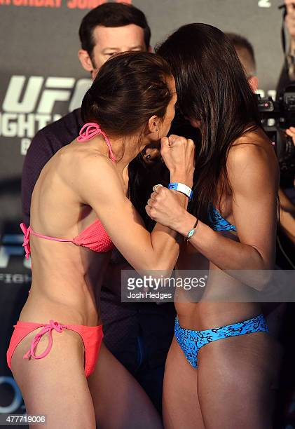 Opponents Joanna Jedrzejczyk of Poland and Jessica Penne of the United States face off during the UFC Berlin weighin at the O2 World on June 19 2015...