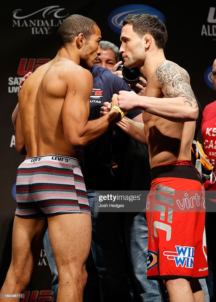 Opponents <a gi-track='captionPersonalityLinkClicked' href=/galleries/search?phrase=Jose+Aldo&family=editorial&specificpeople=6912631 ng-click='$event.stopPropagation()'>Jose Aldo</a> and <a gi-track='captionPersonalityLinkClicked' href=/galleries/search?phrase=Frankie+Edgar&family=editorial&specificpeople=5446046 ng-click='$event.stopPropagation()'>Frankie Edgar</a> face off during the UFC 156 weigh-in on February 1, 2013 at Mandalay Bay Events Center in Las Vegas, Nevada.