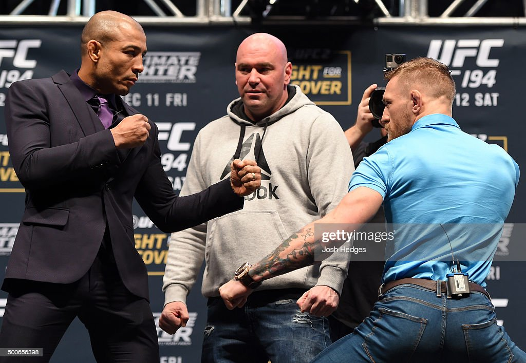 Opponents Jose Aldo of Brazil and Conor McGregor of Ireland face off during the UFC Press Conference inside MGM Grand Garden Arena on December 9, 2015 in Las Vegas, Nevada.