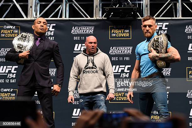 Opponents Jose Aldo of Brazil and Conor McGregor of Ireland pose for photos during the UFC Press Conference inside MGM Grand Garden Arena on December...
