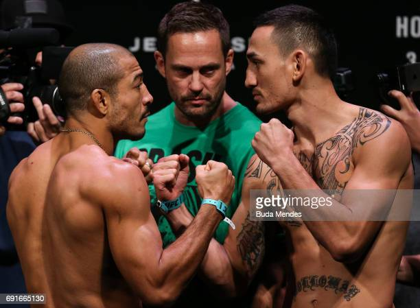 Opponents Jose Aldo of Brazil and Max Holloway of the United States face off during the UFC Fight Night weighin at Jeunesse Arena on June 02 2017 in...